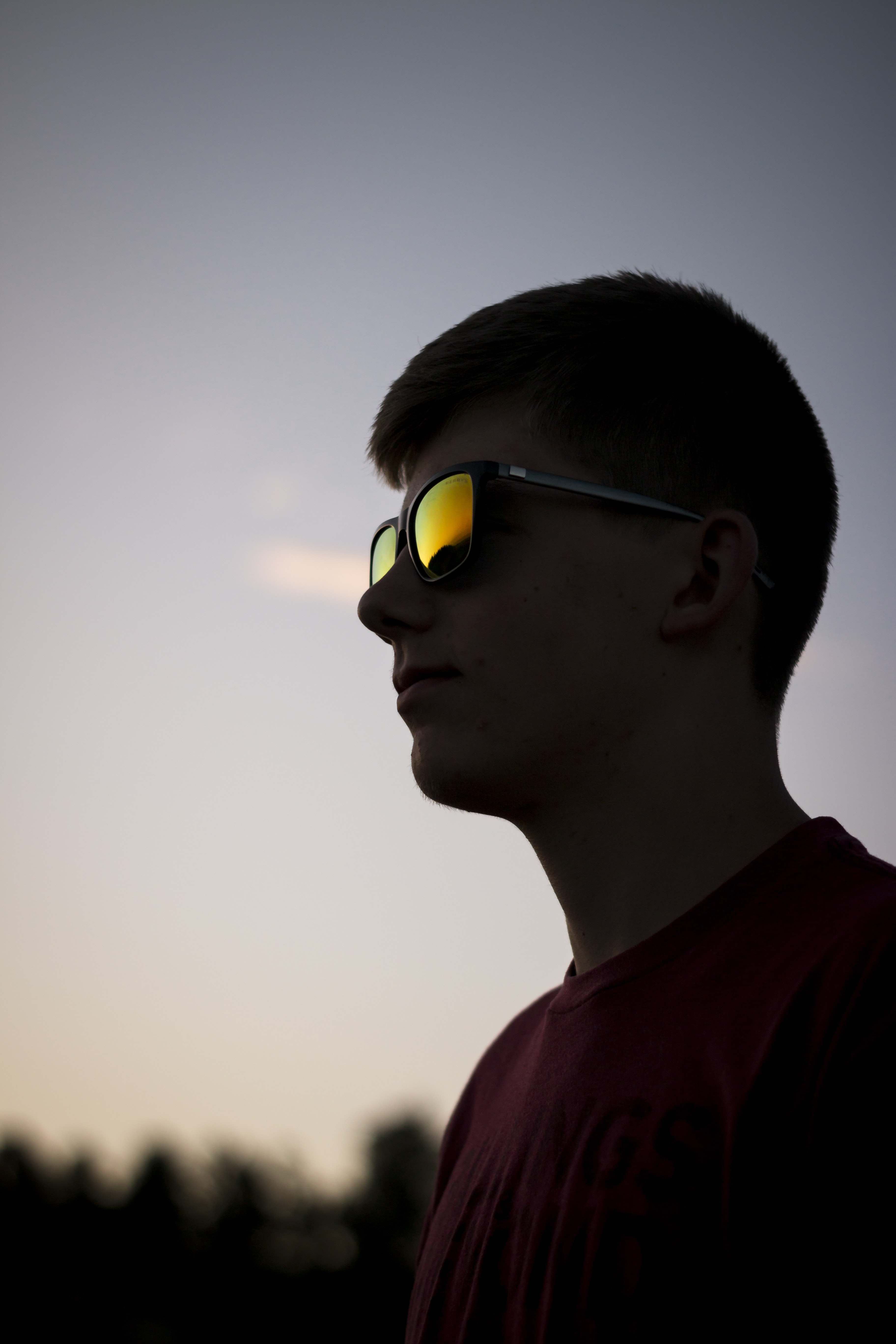 shallow focus photography of man wearing sunglasses