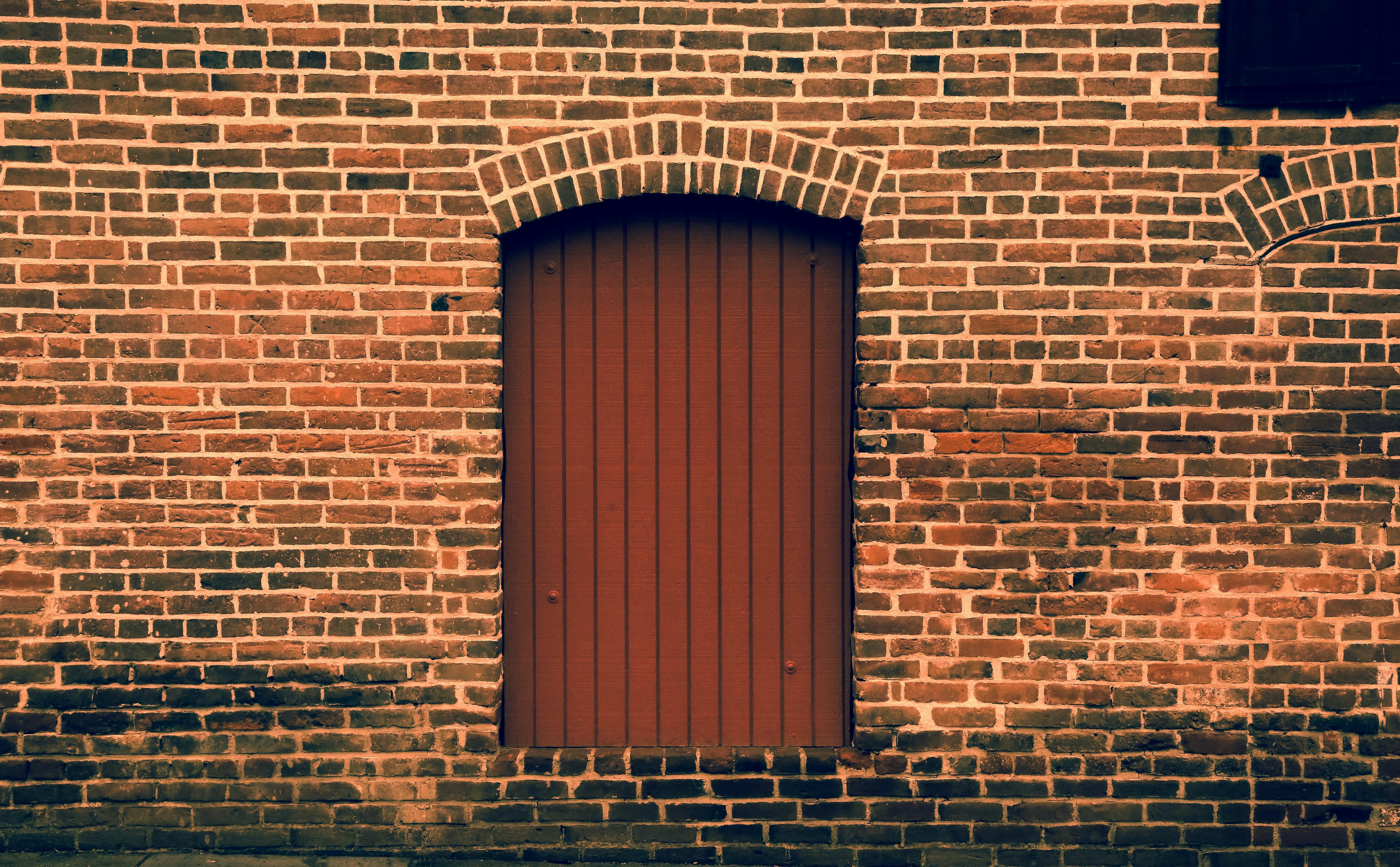 closed brown metal door