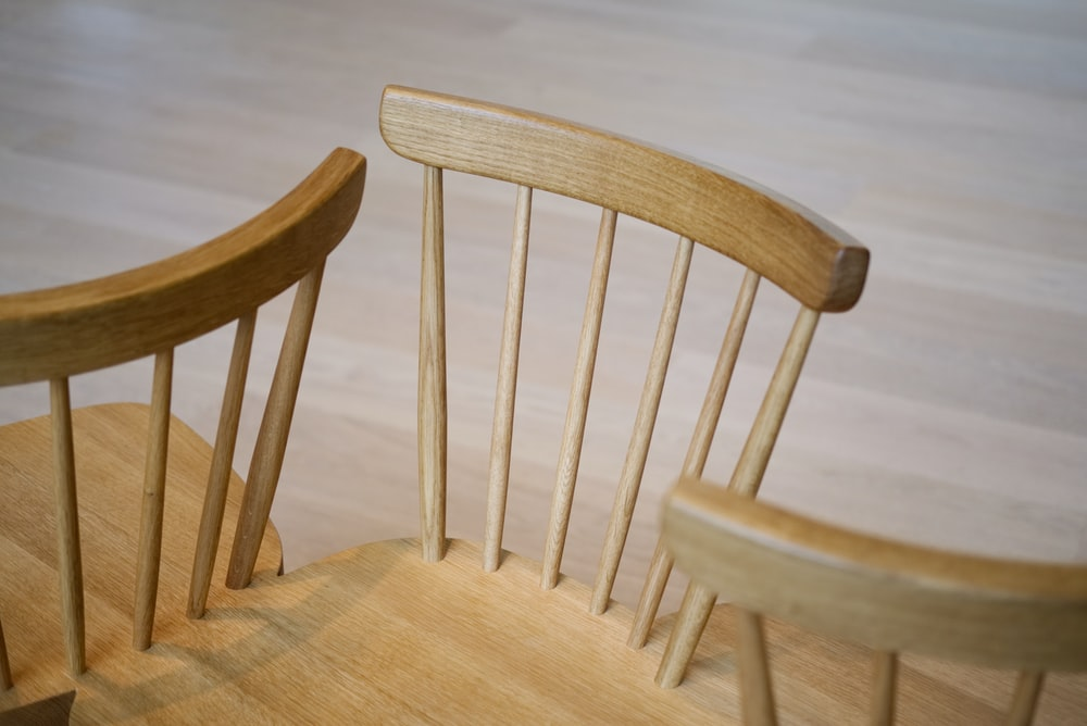 three brown wooden Windsor chairs