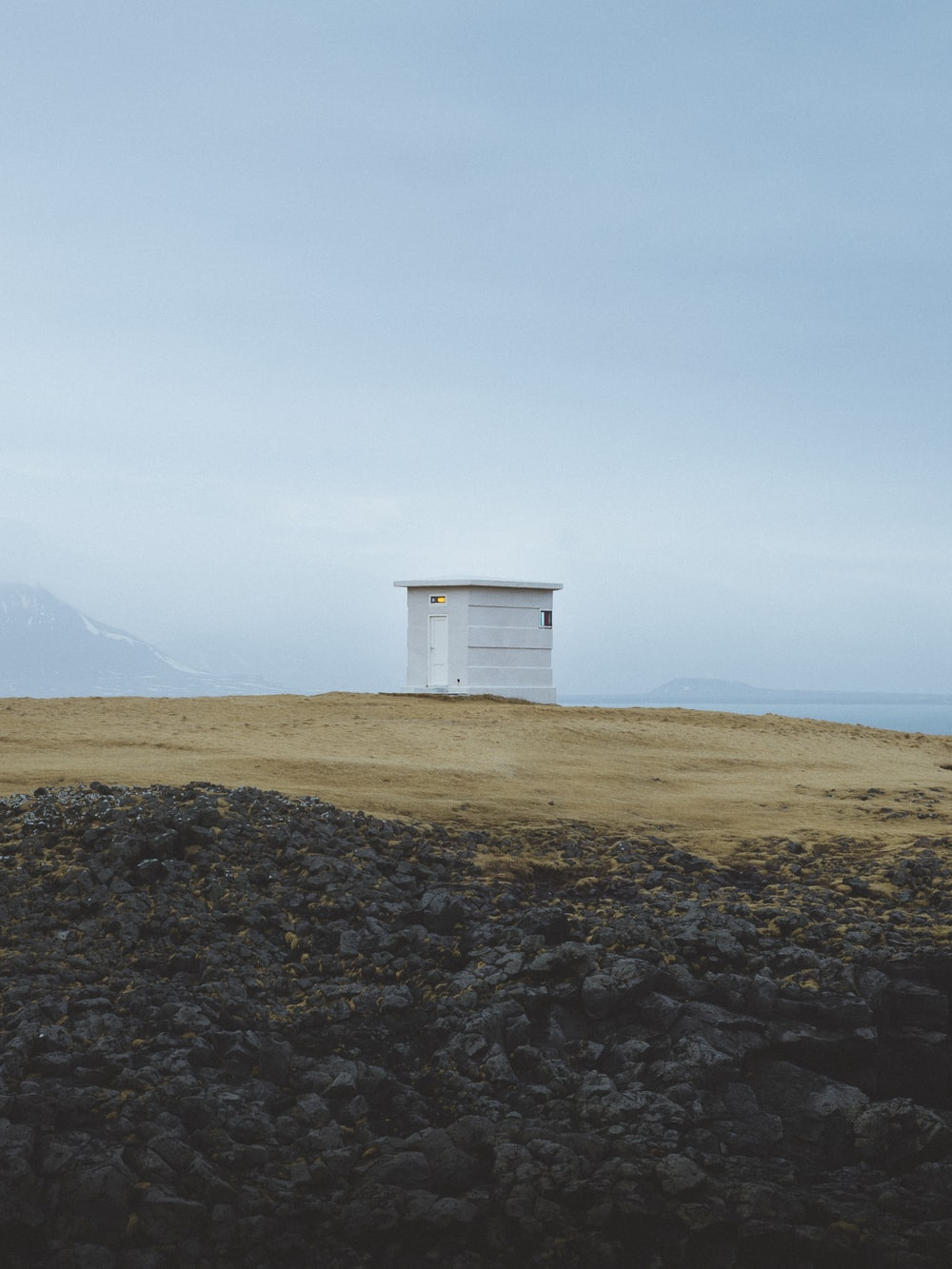 white wooden shed on top of hill