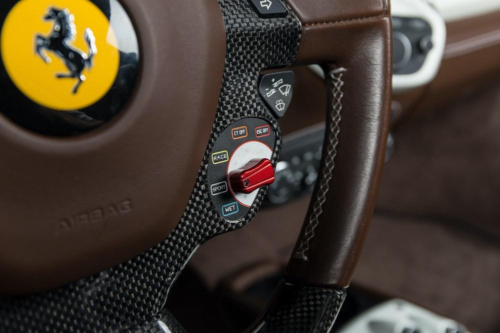 brown and black Ferrari car steering wheel