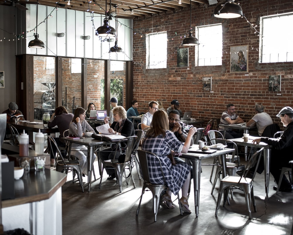 people sitting on restaurant chairs
