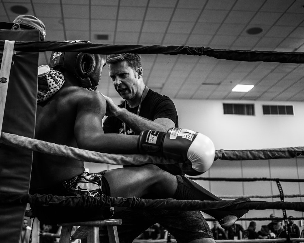 greyscale photography of a boxer inside reing