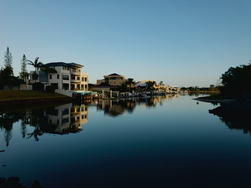 panoramic photography of white concrete house beside body of water