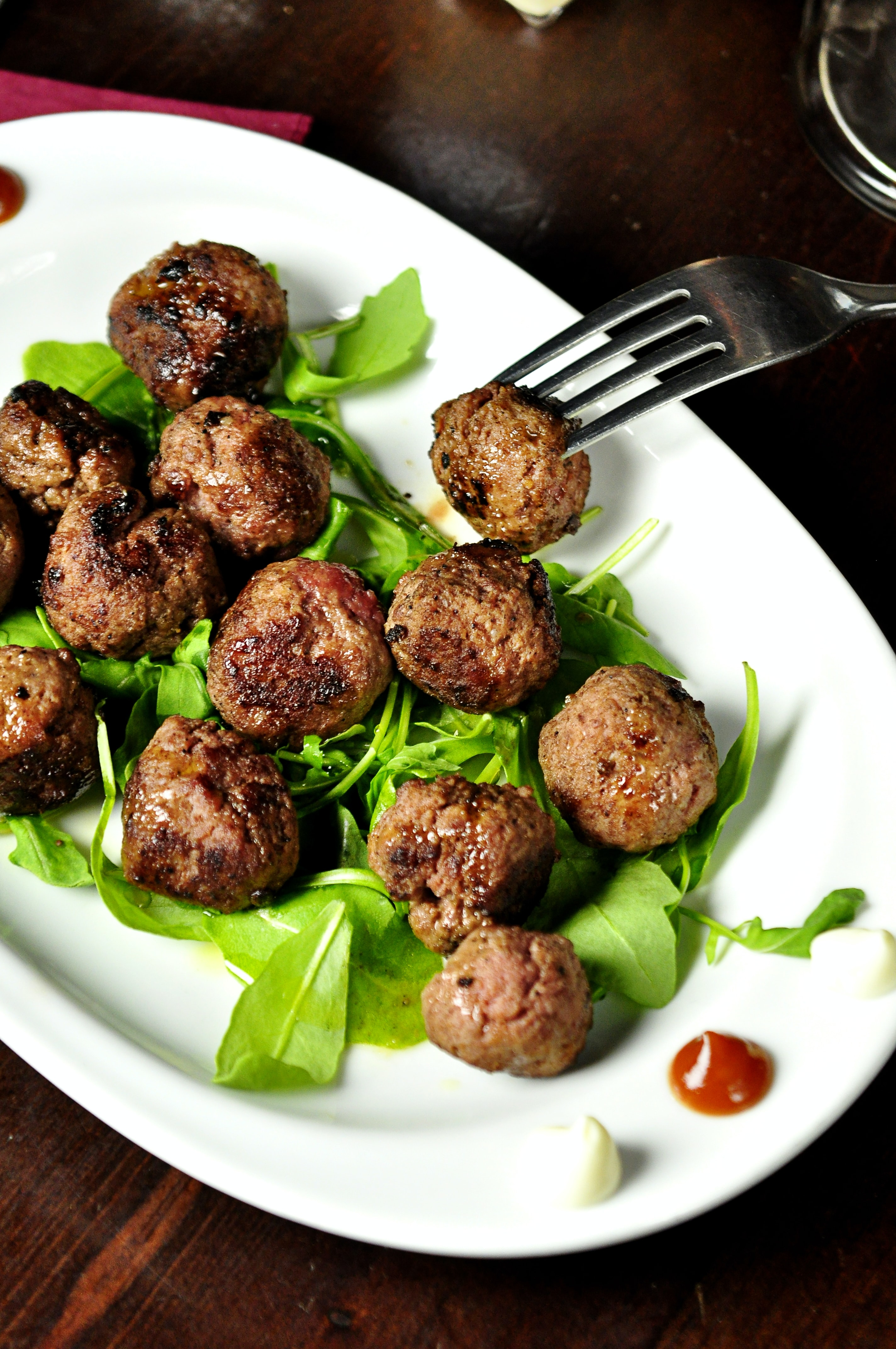 meat balls on oval white plate
