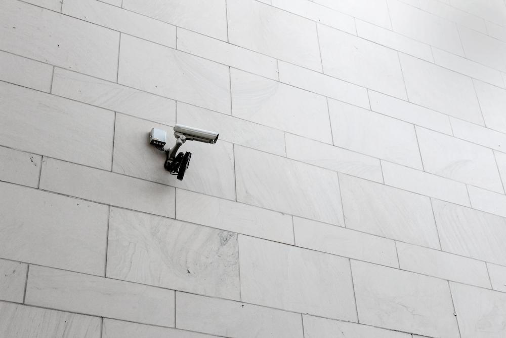grey surveillance camera on wall