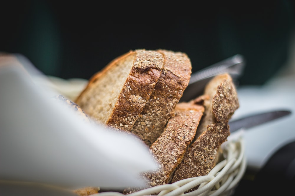closeup photo of breads in basket