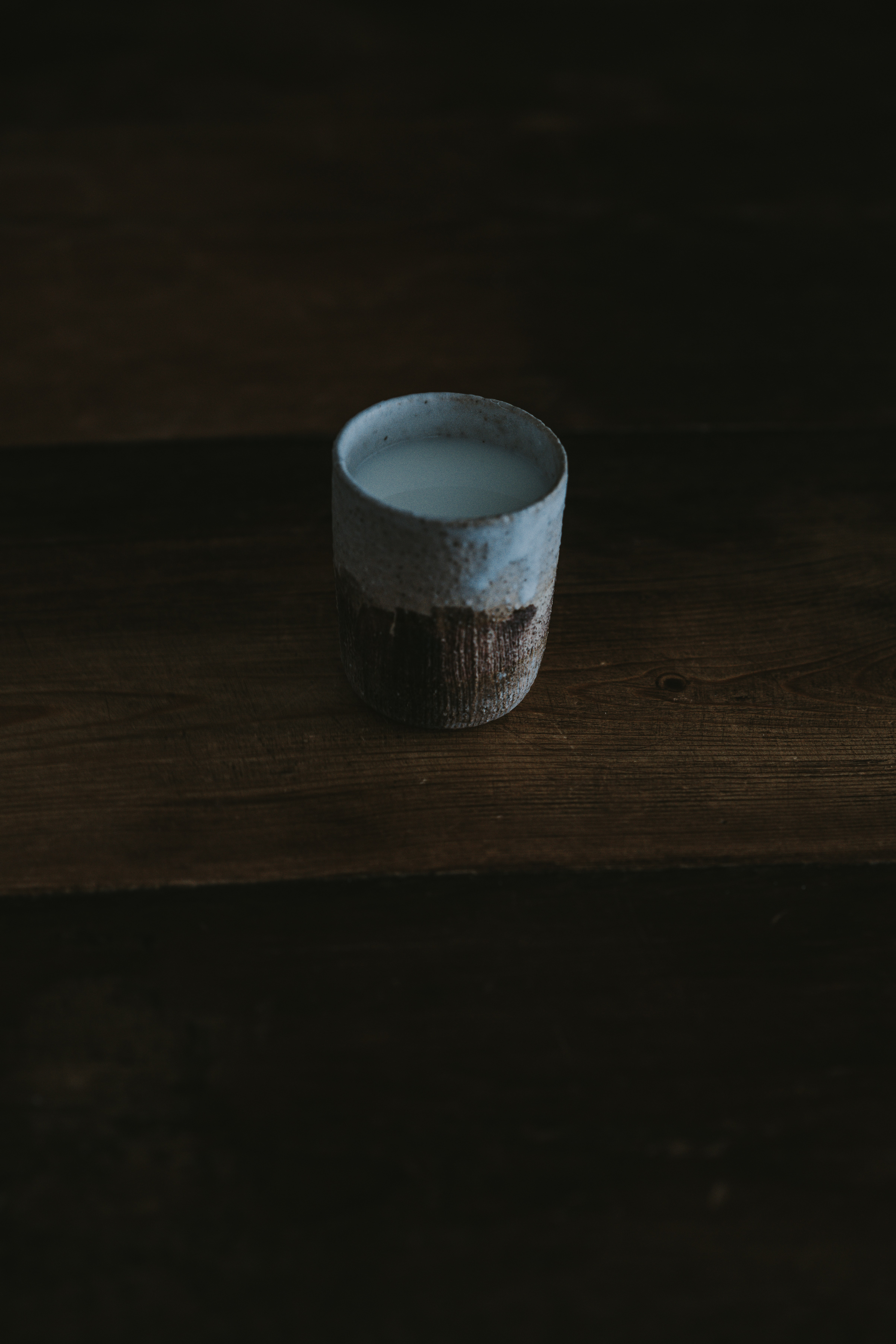 white and brown ceramic cup
