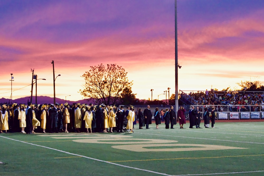 graduates gathered on football field