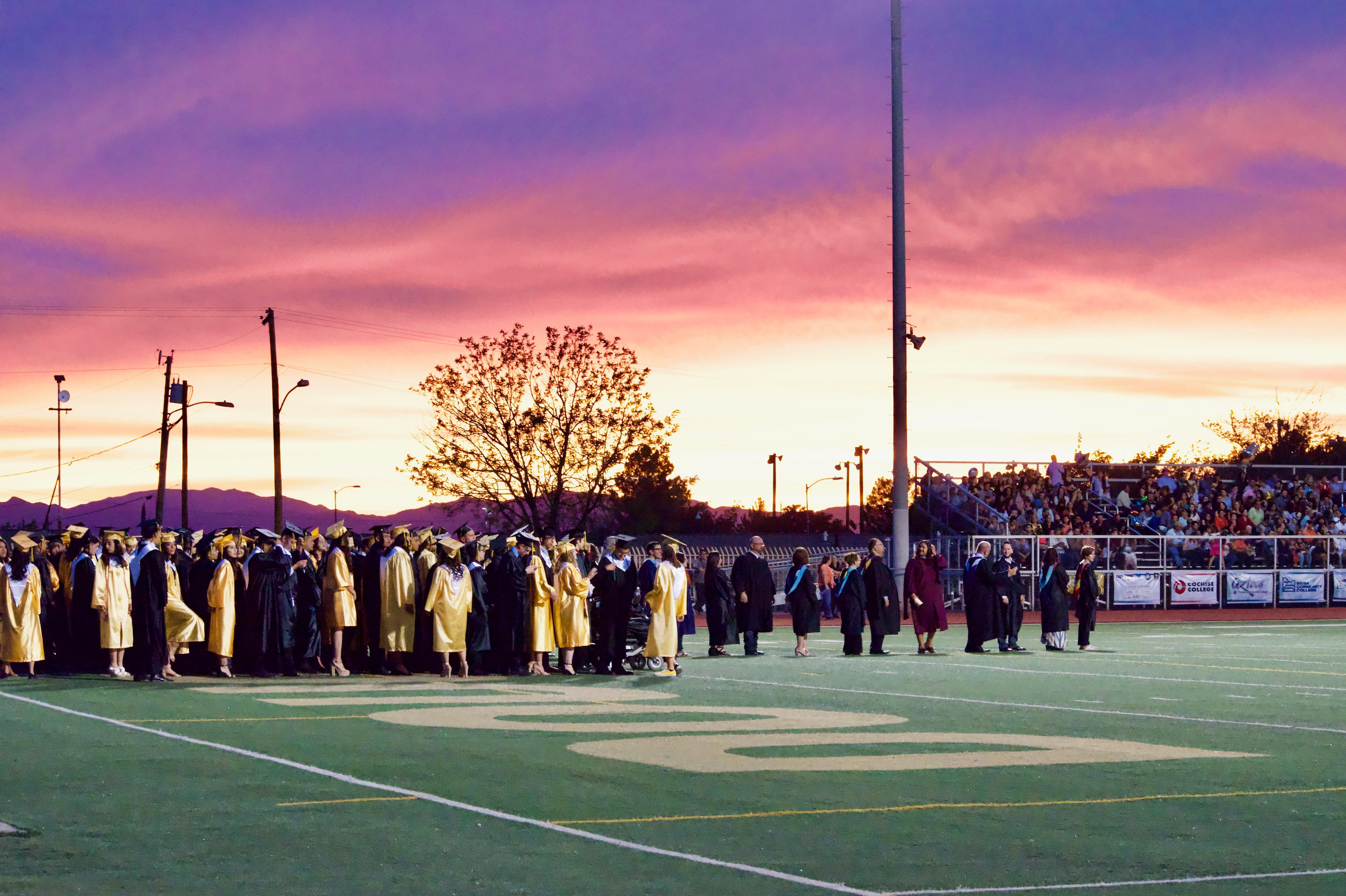 graduates gathered on football field