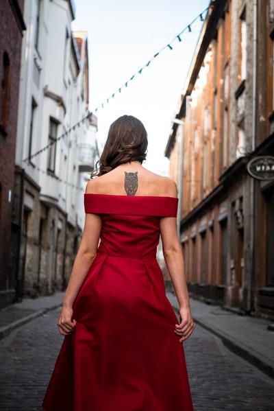 woman wearing red off-shoulder dress