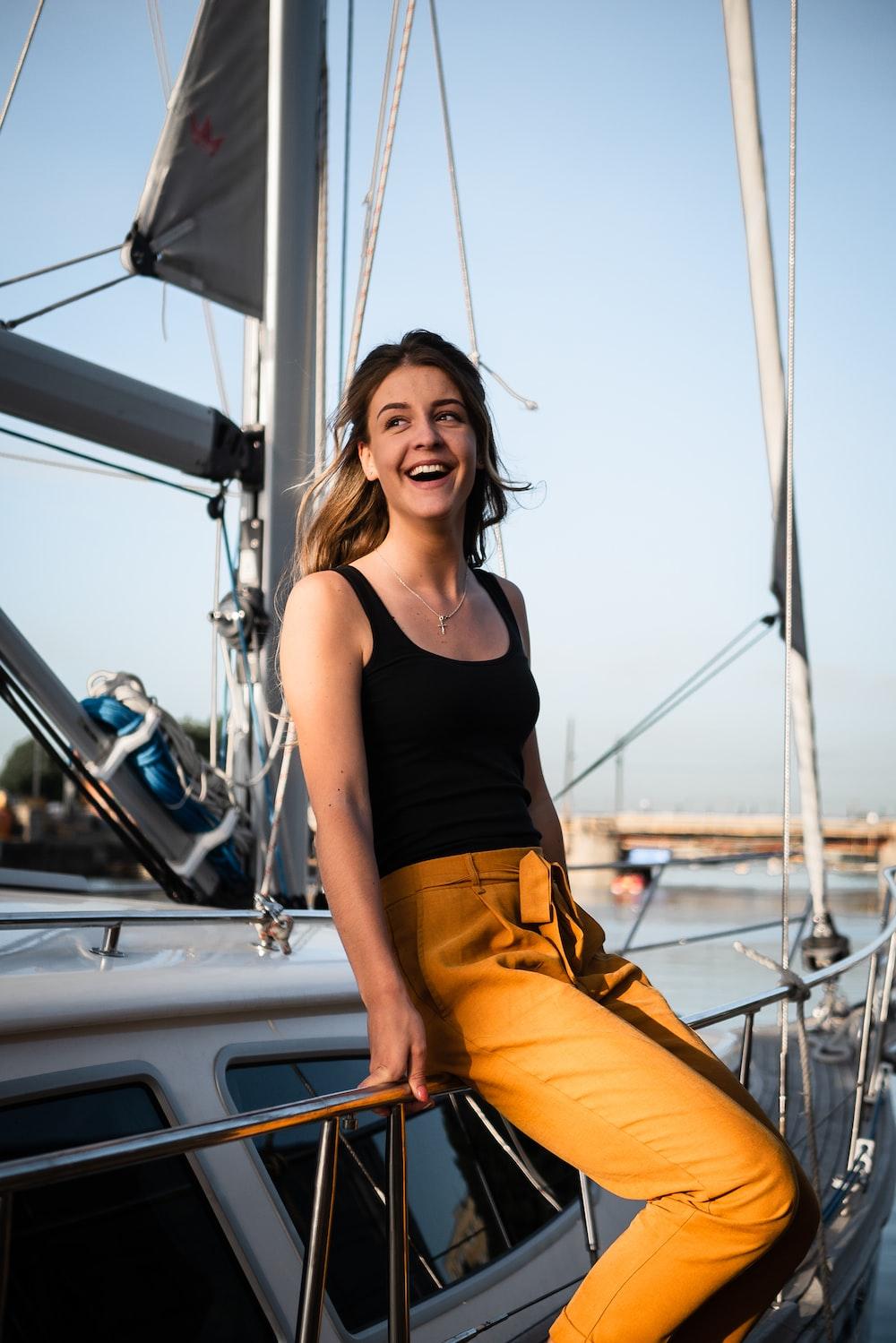 woman sitting on white yacht