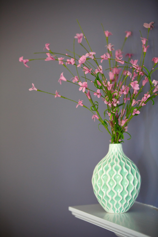 pink petaled flowers on green vase
