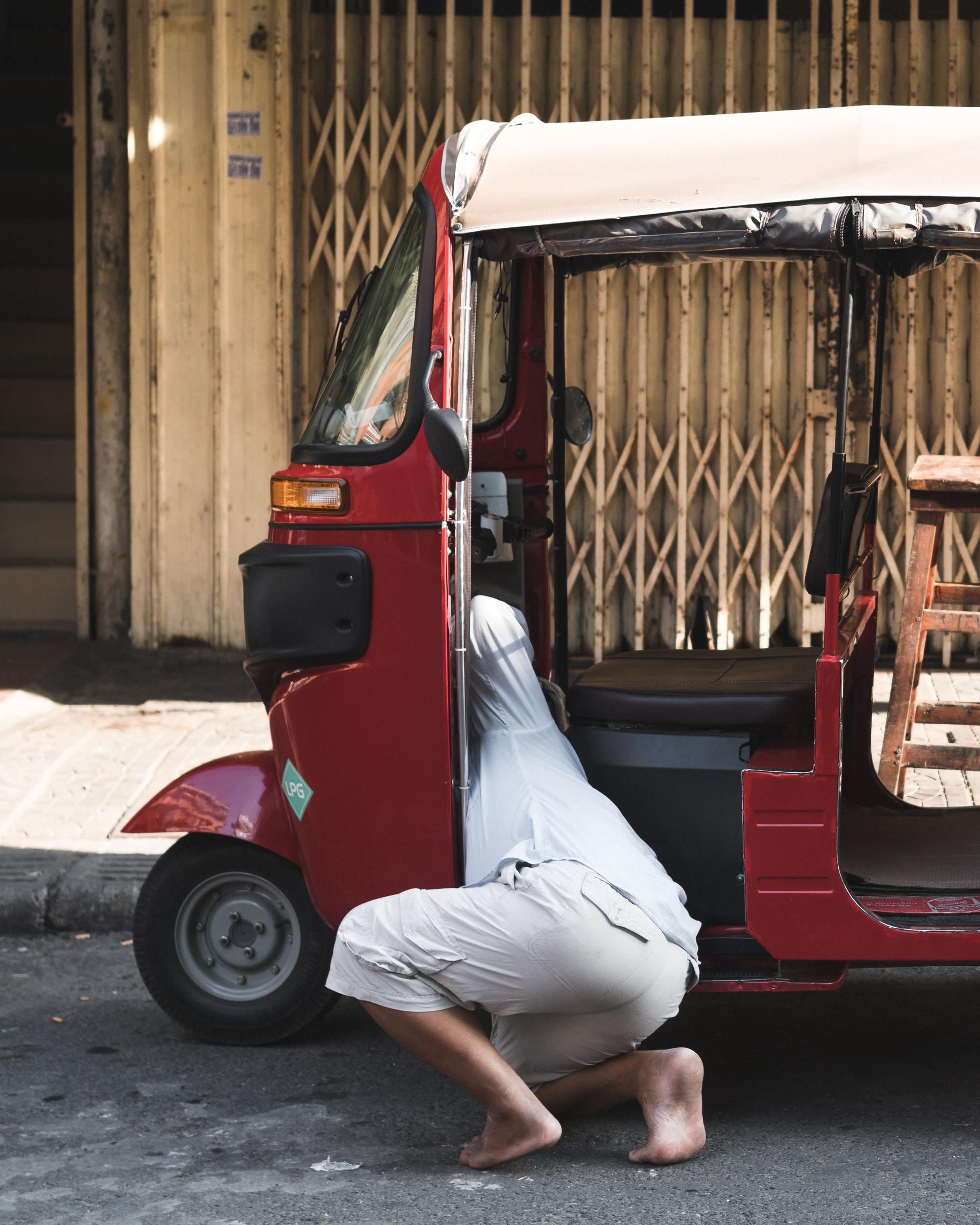 person kneeling in side cart