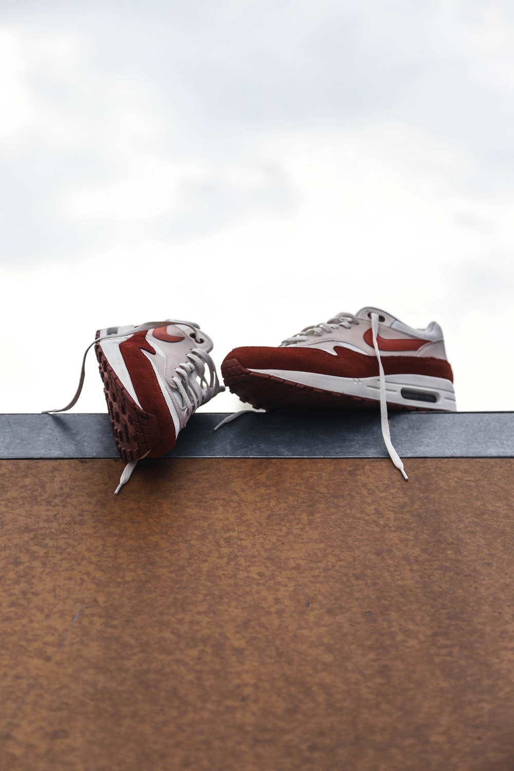 white-and-red Nike sneakers at daytime