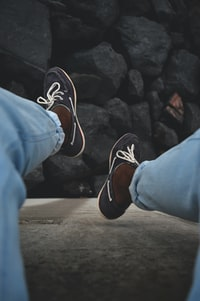 person wearing blue boat shoes