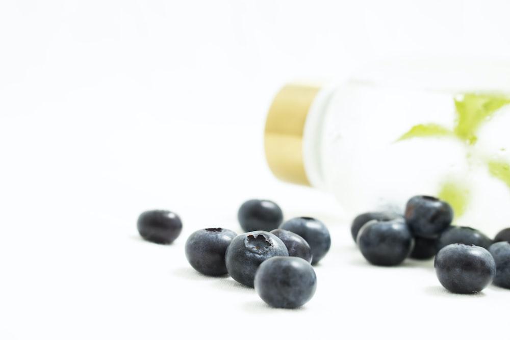 clear glass bottle near fruits