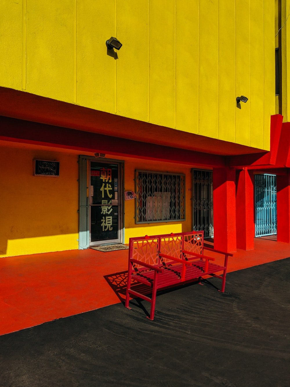 red bench in front of store facade