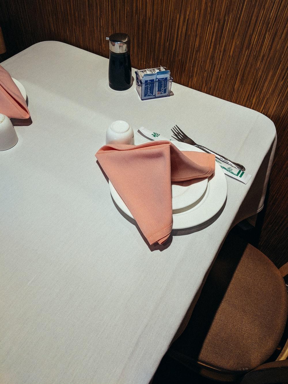 orange table napkin on plate