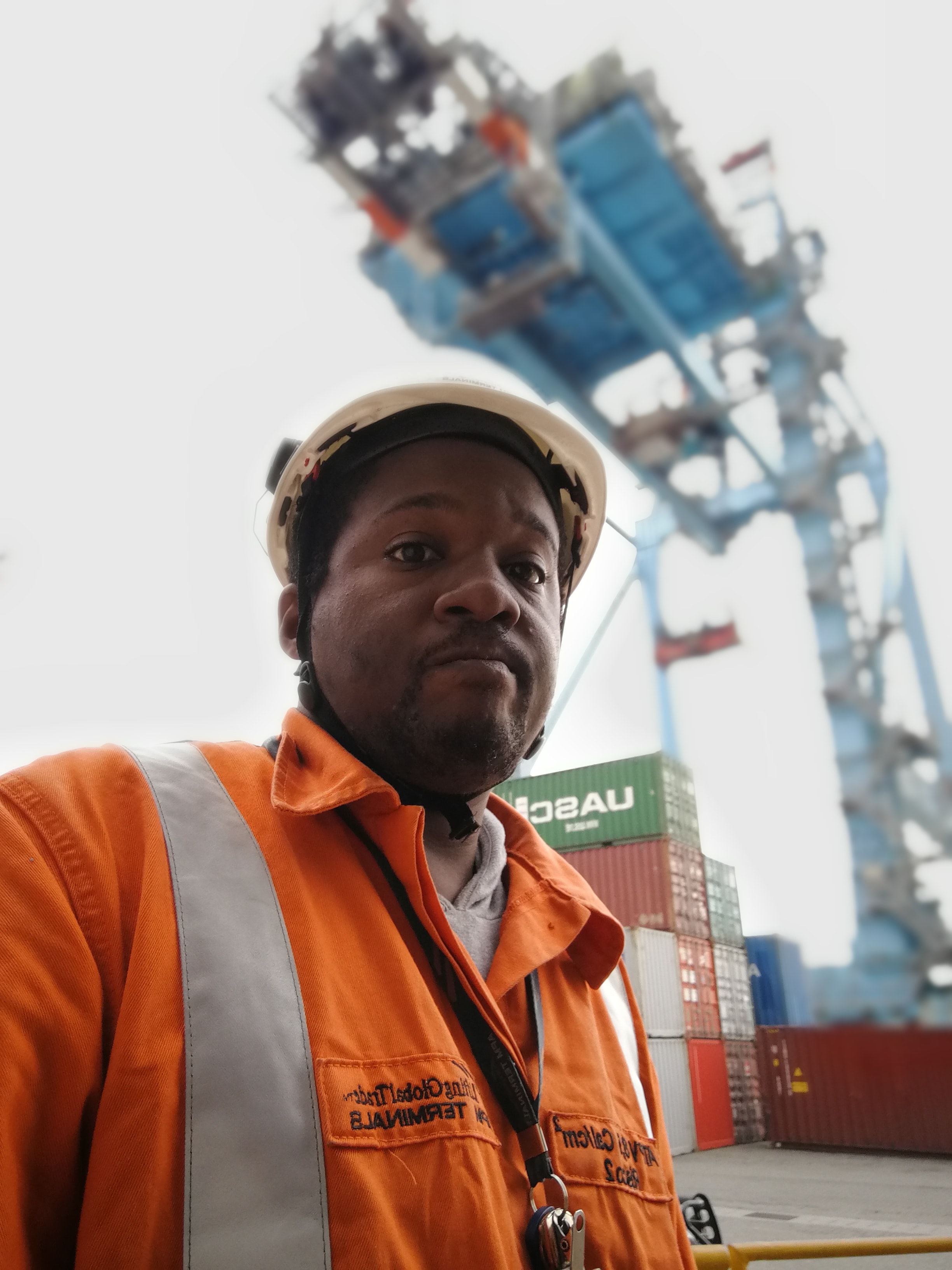 selective focus photography of man wearing hard hat and collared top