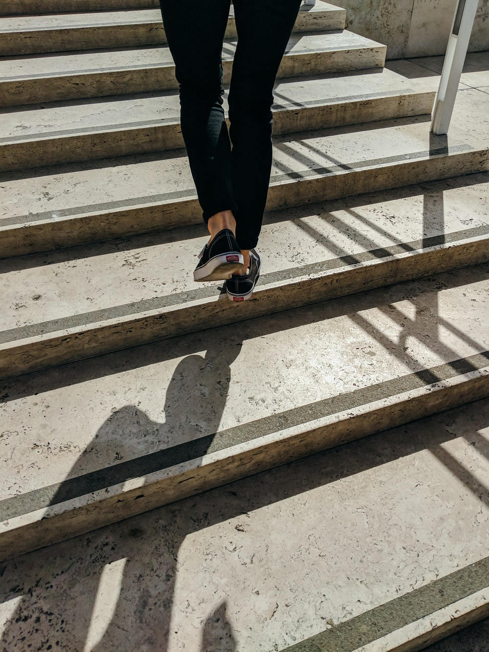 person walking on concrete stair