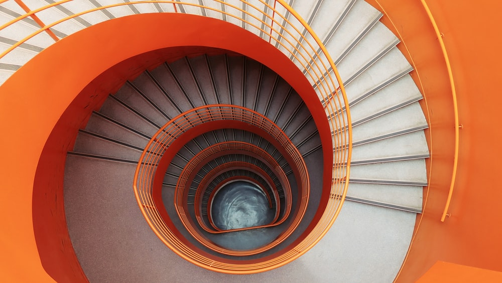 empty spiral stairs on low-angle photograph