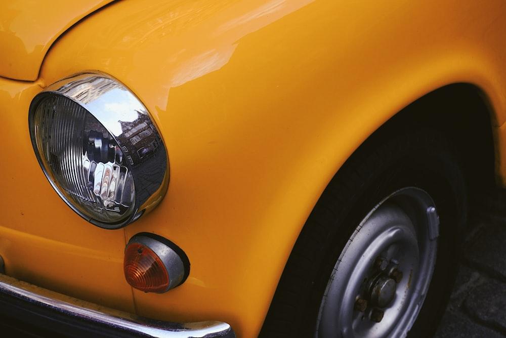 closeup photo of yellow car