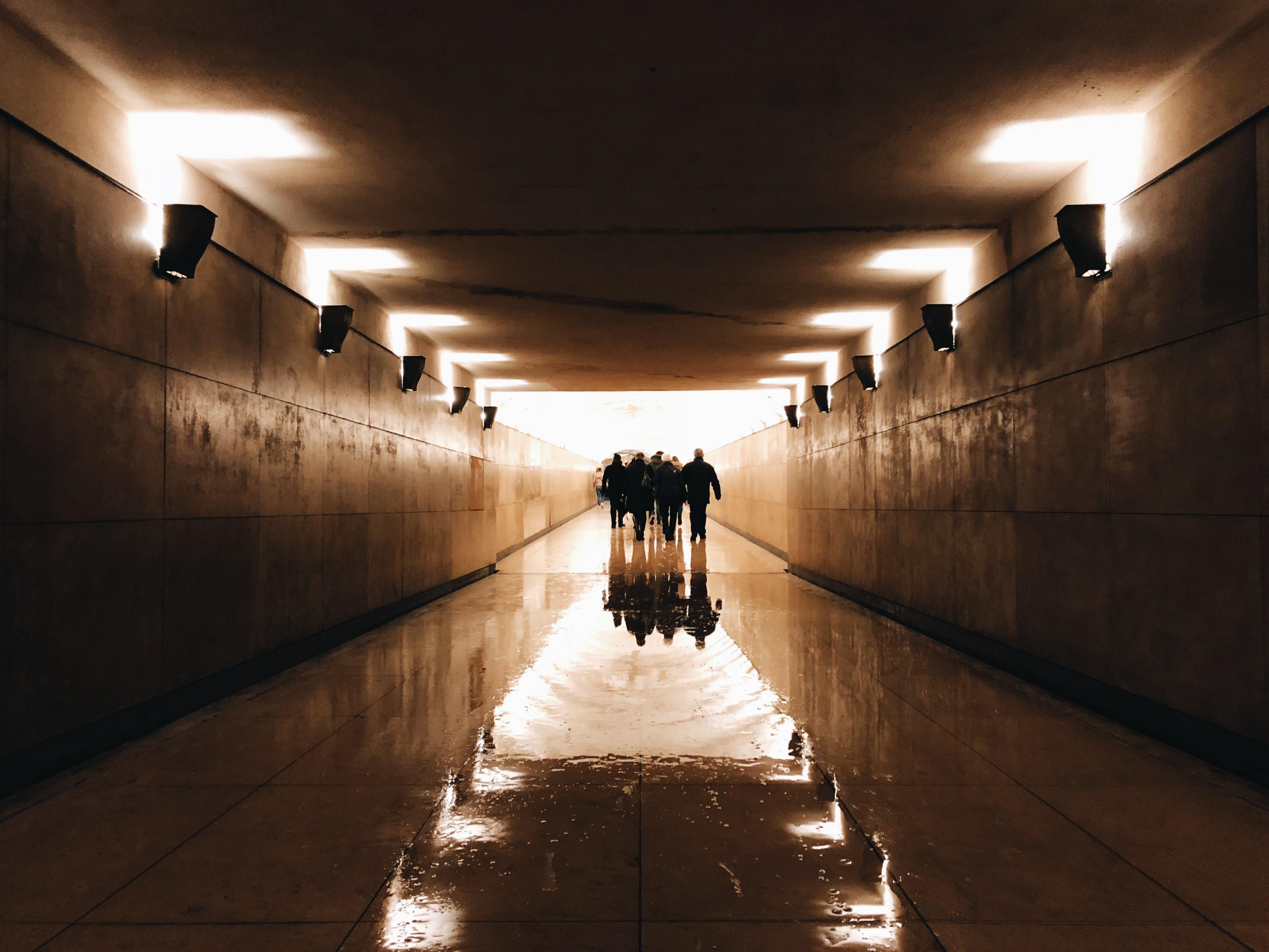 group of people walking on corridor