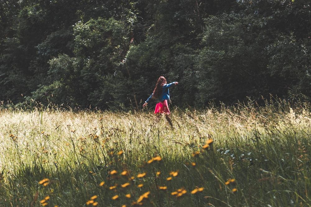 woman standing on green grass field