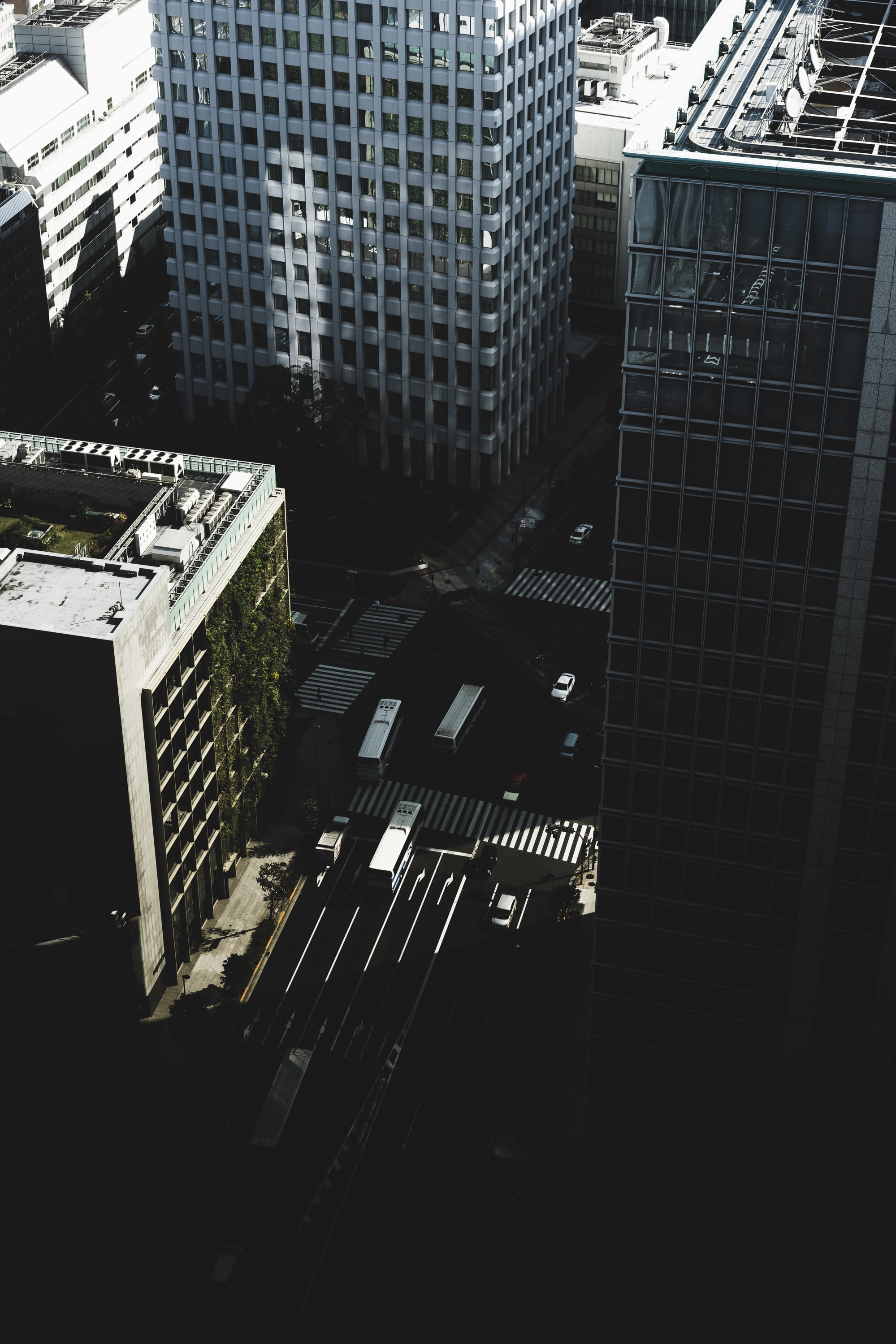 bird's eye view photography of streets and vehicles surrounded by buildings