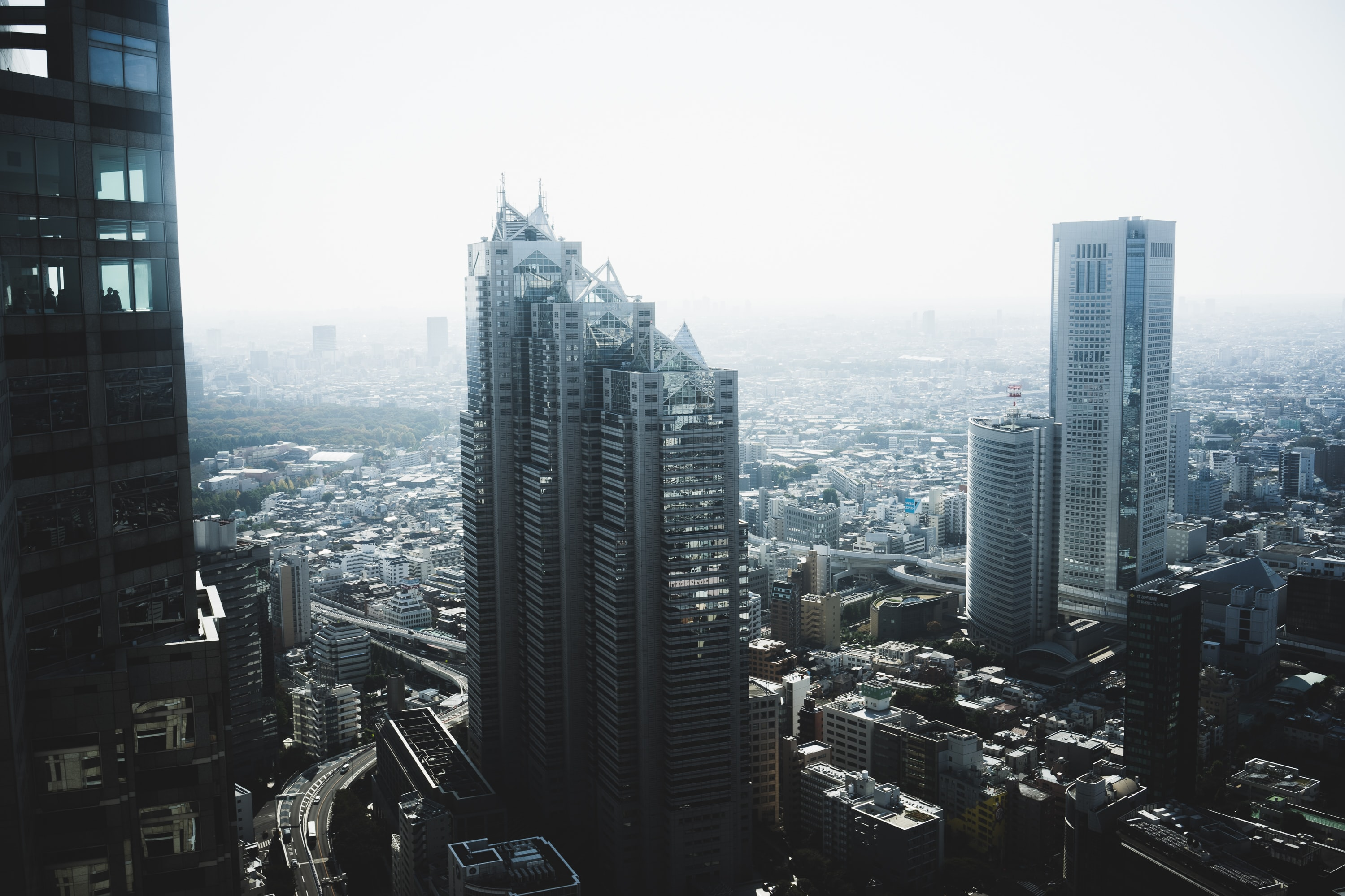 photo of concrete buildings under cloudy sky