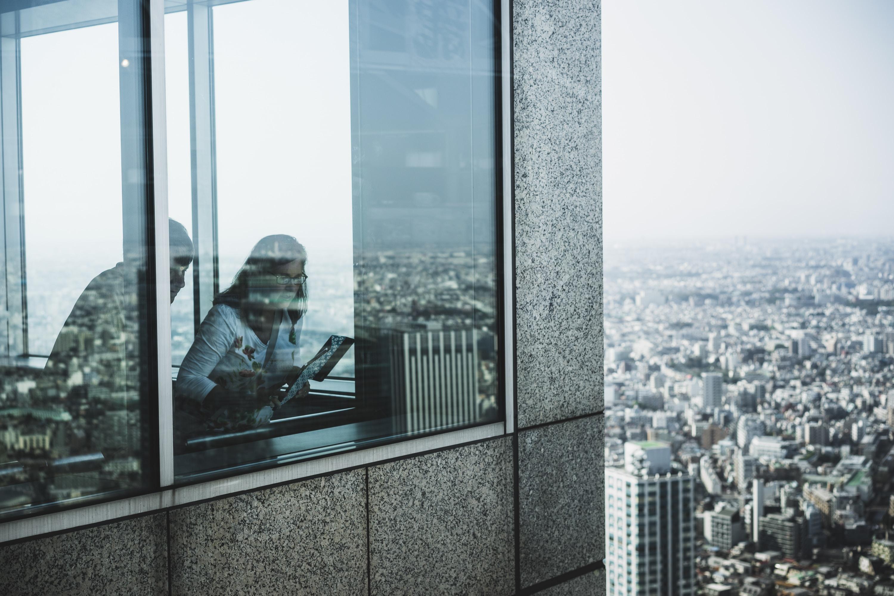 woman standing near window
