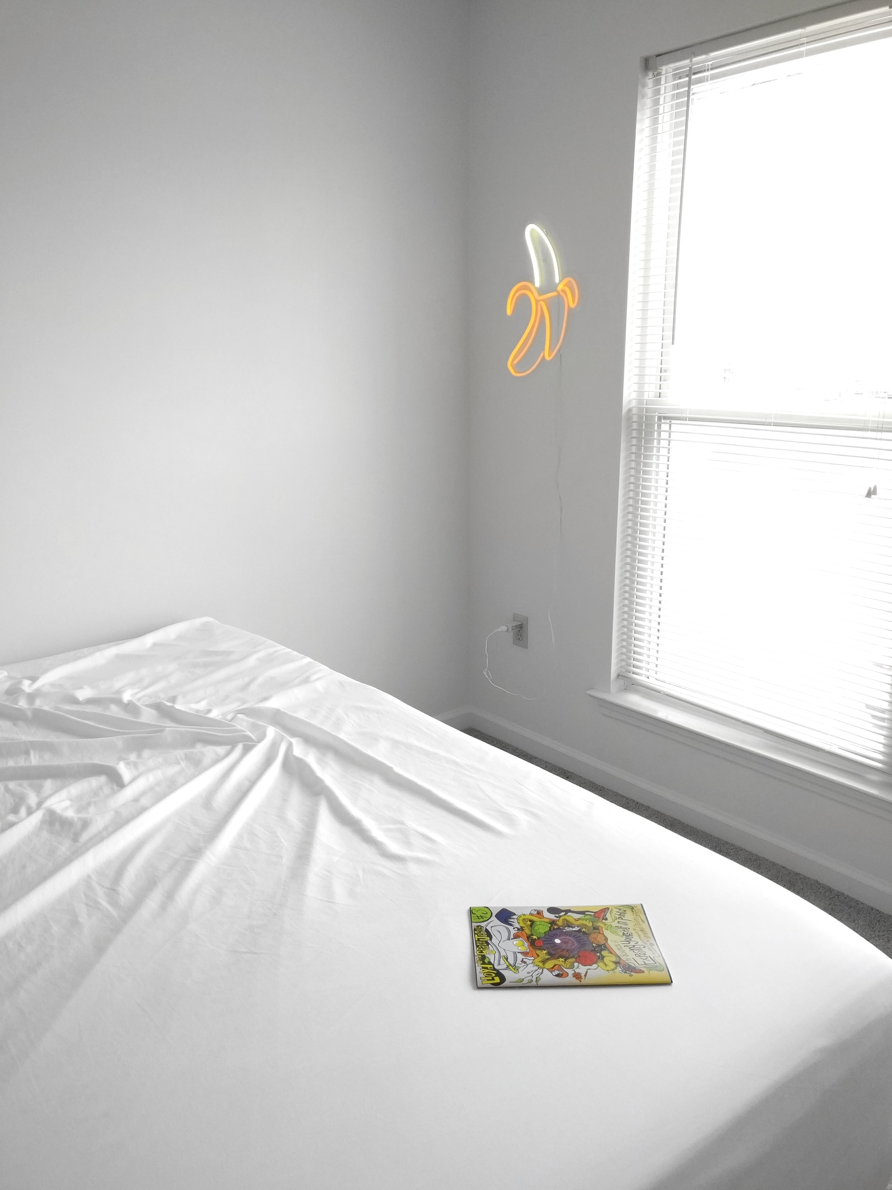 white bed comforter near window