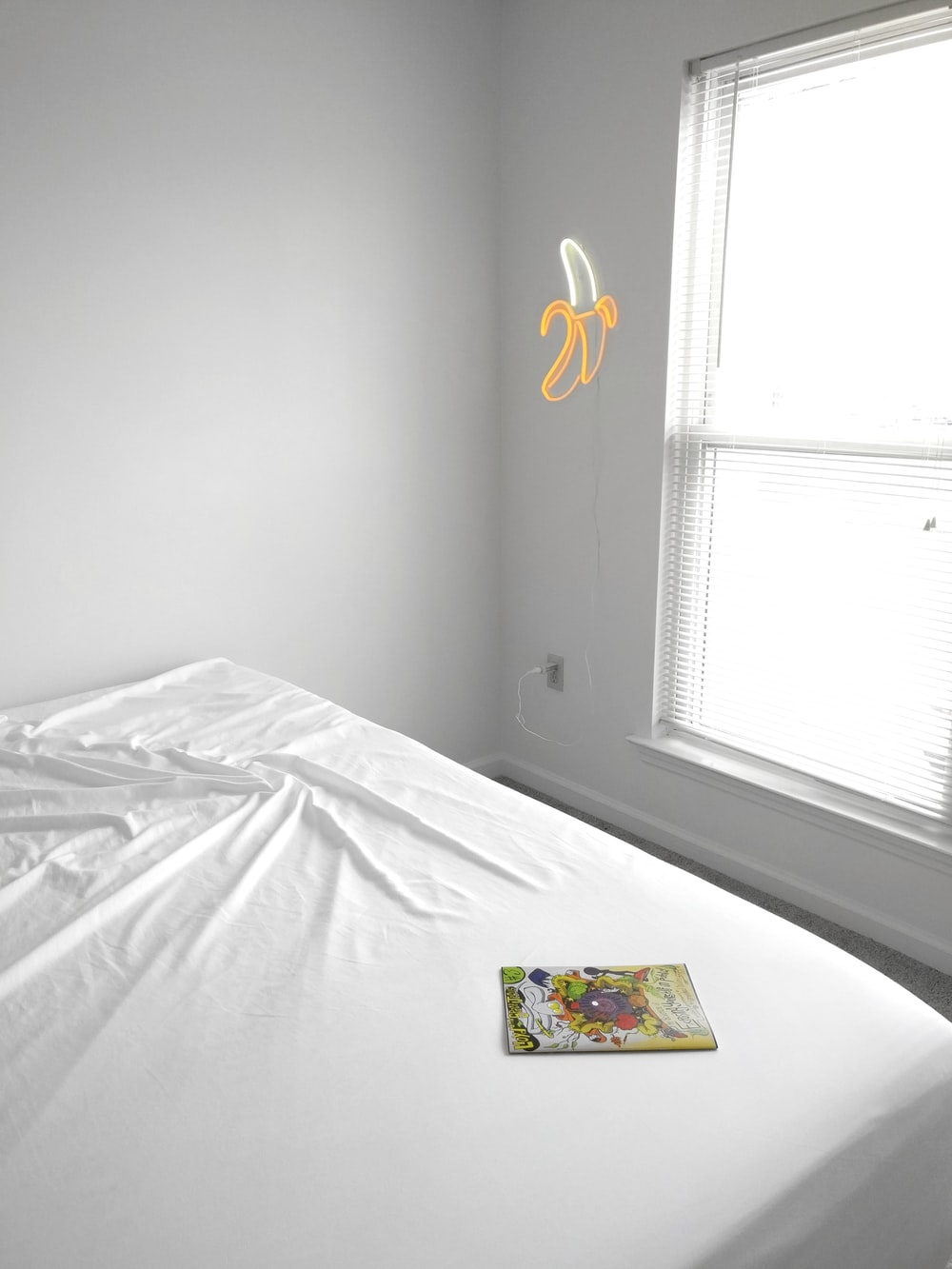 white bed comforter near window