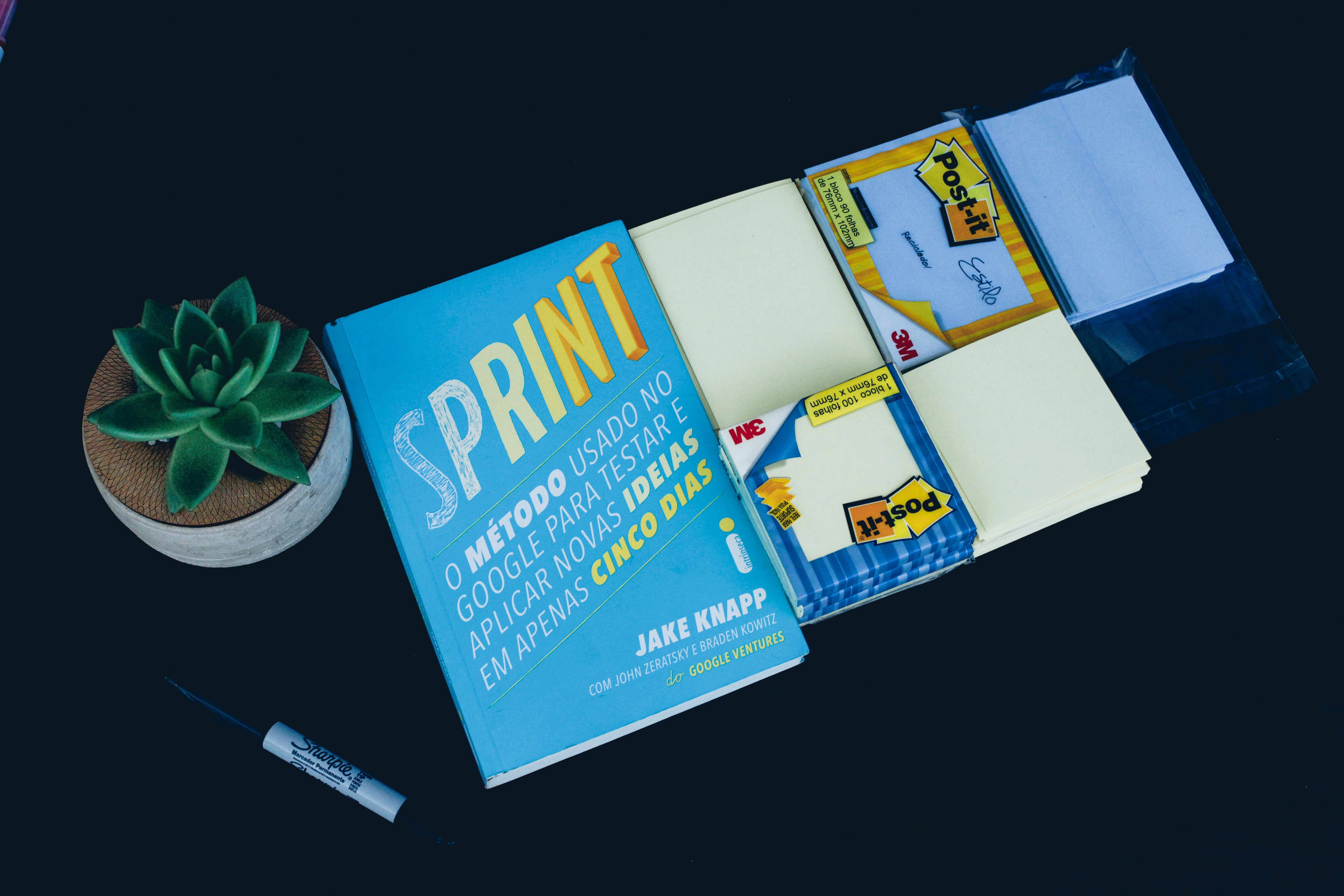 Sprint book and black marker