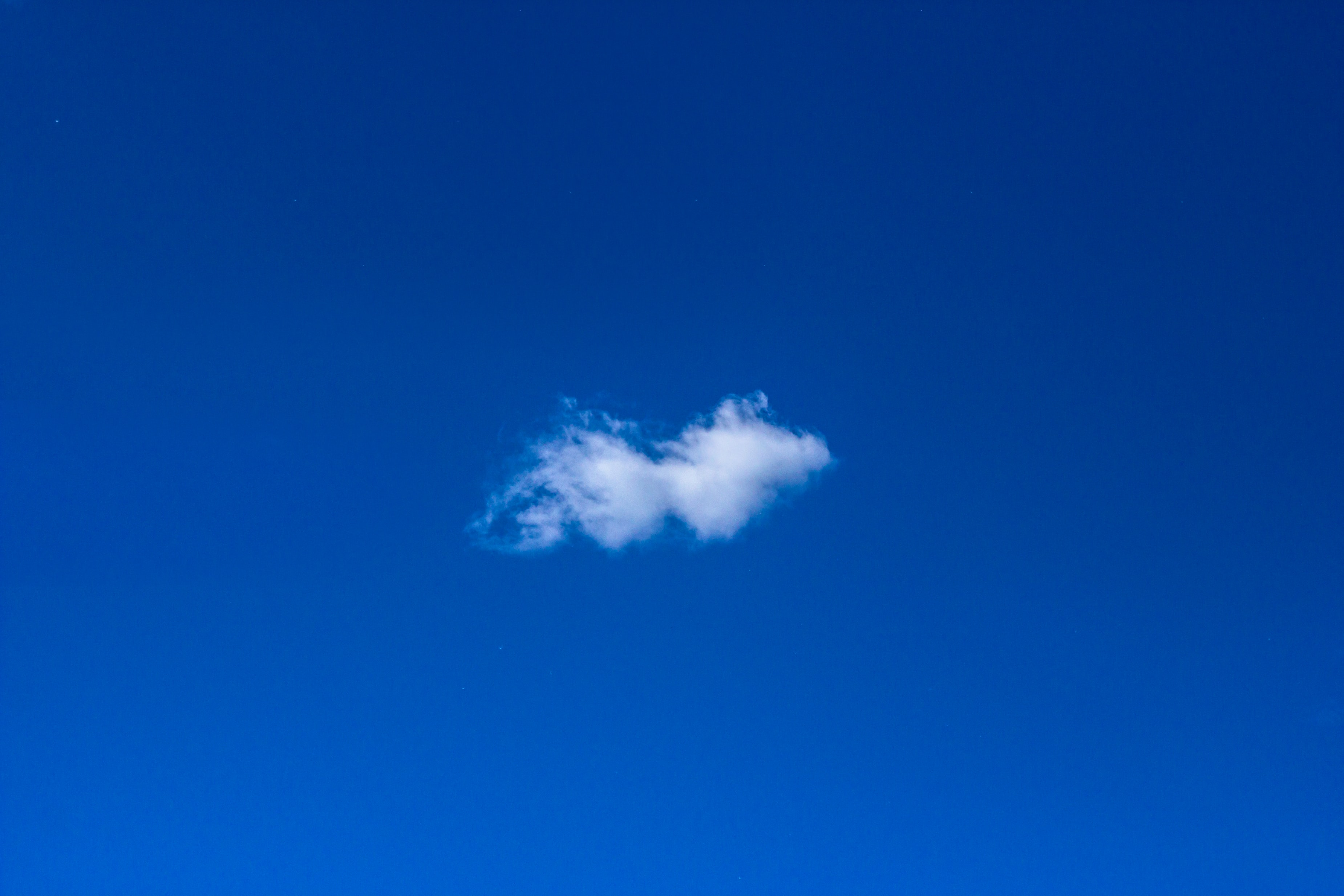 white cloud under clear sky