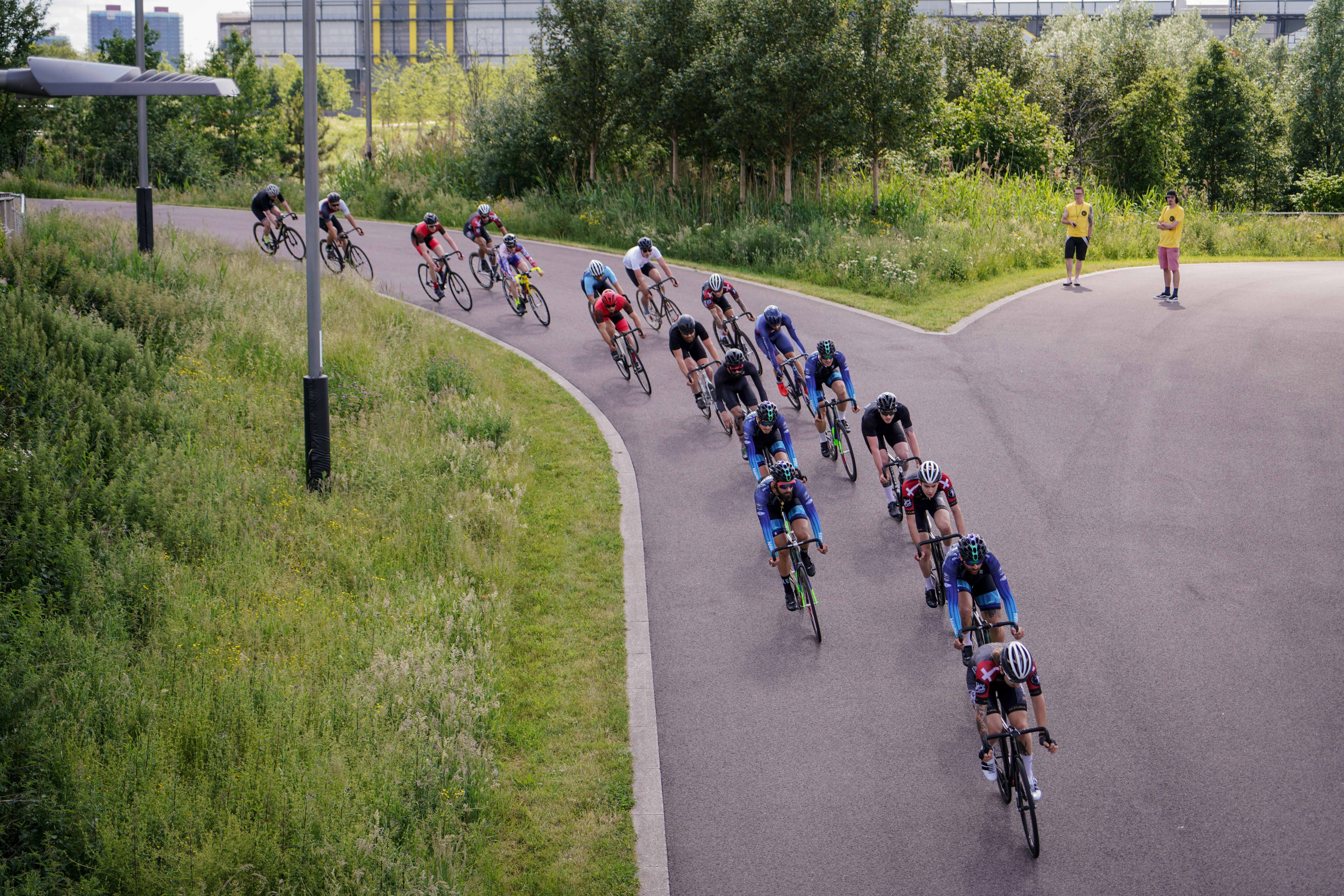 bike riders on road near trees