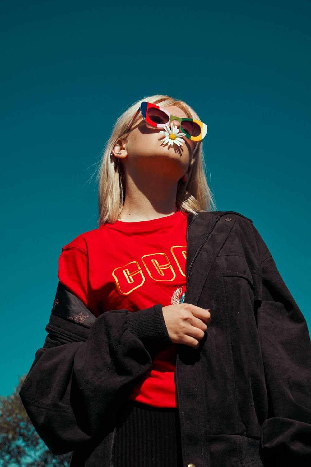 woman with sunglasses standing outdoor during daytime