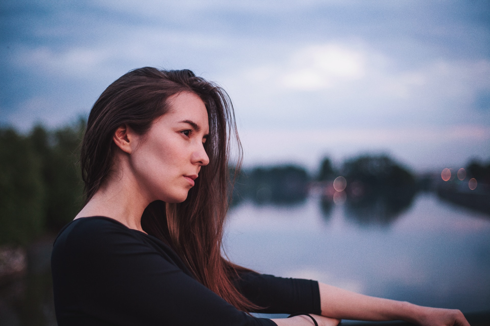 depth photography of woman in 3/4-sleeved top near body of water
