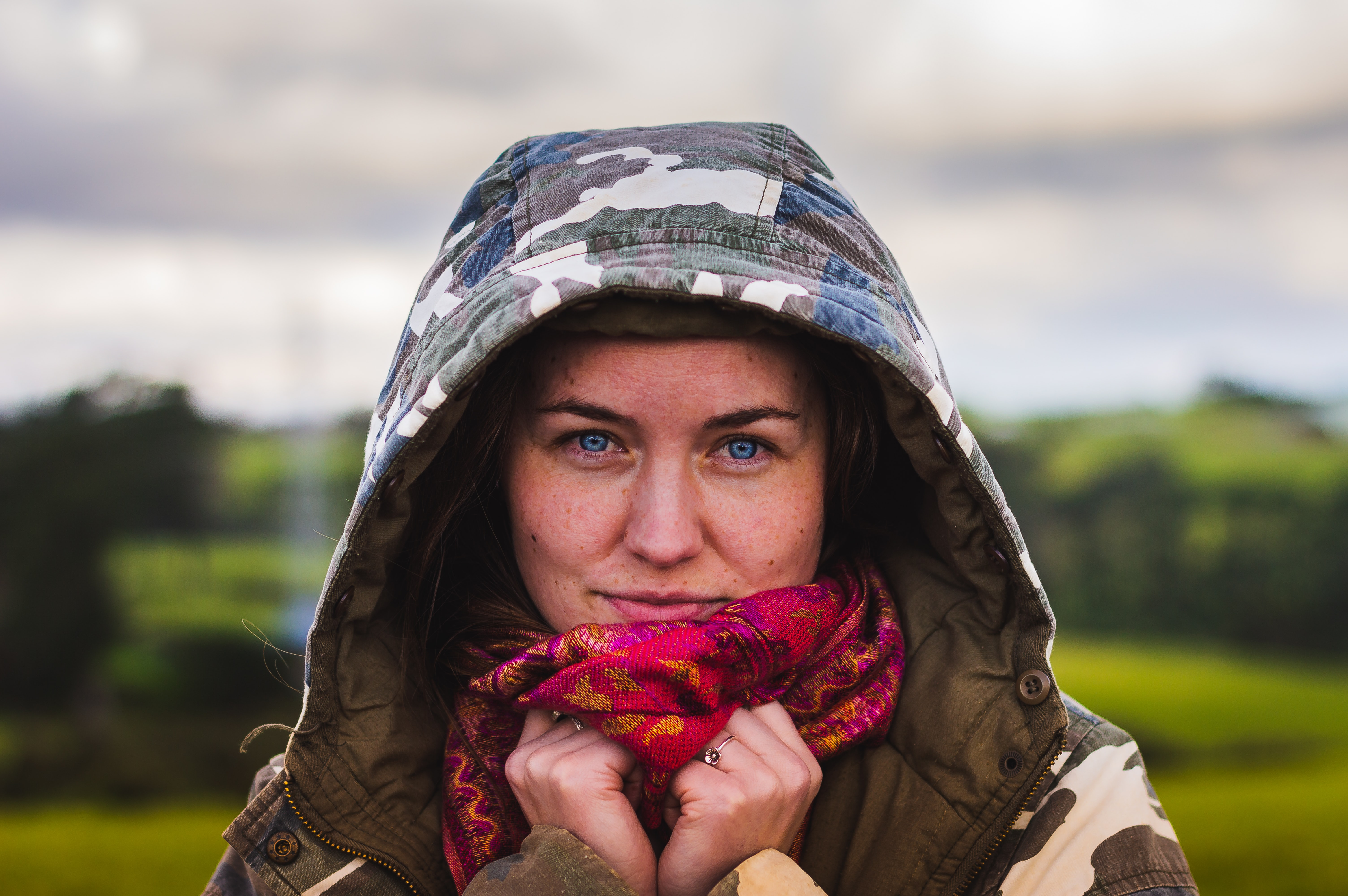 woman wearing gray and white camouflage hoodie
