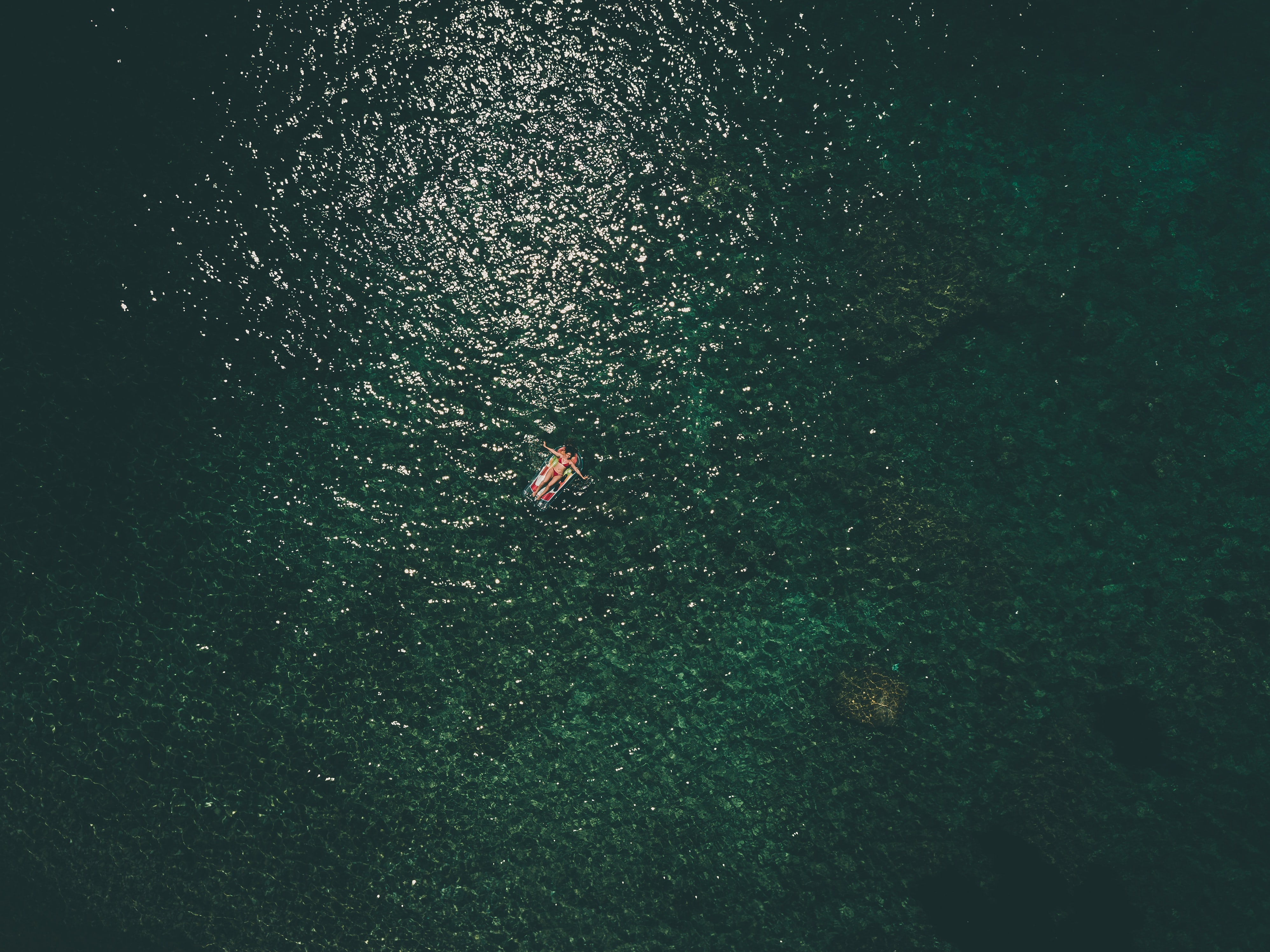person riding on boat in aerial photogrphy