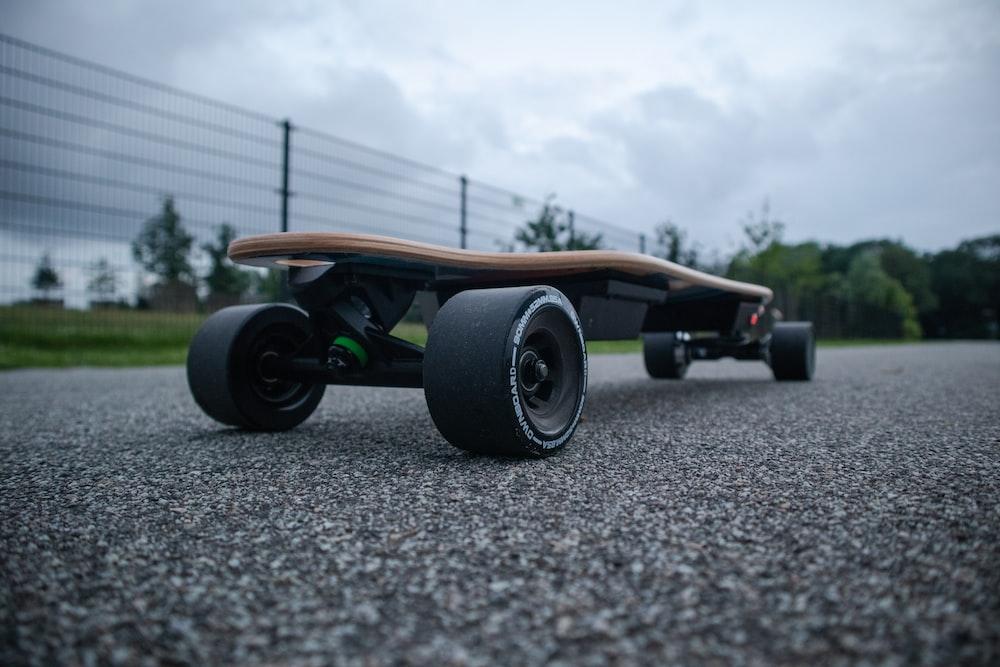 longboard on concrete road
