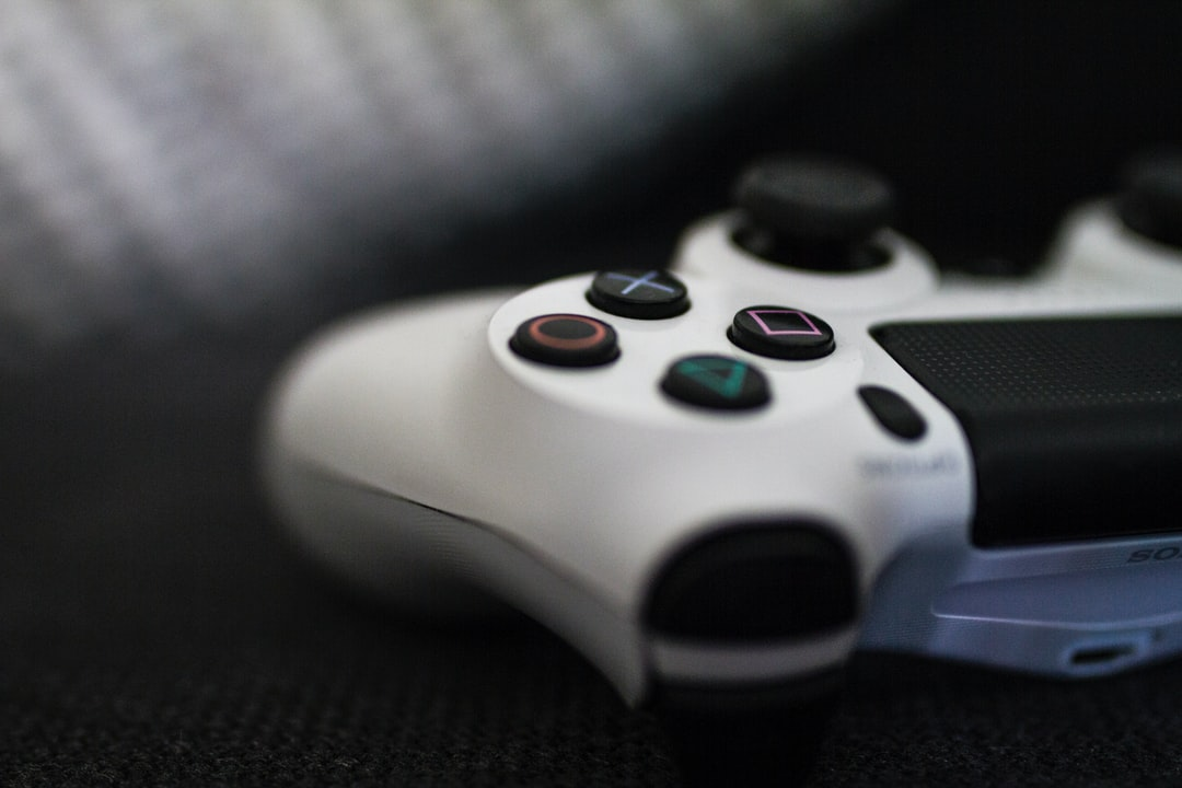 closeup of white Sony PS4 controller