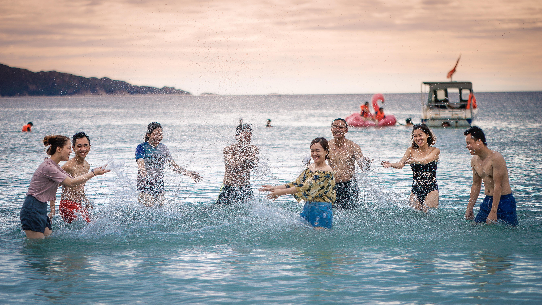 people splashing body of water on sea
