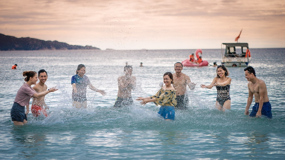 people splashing body of water on sea