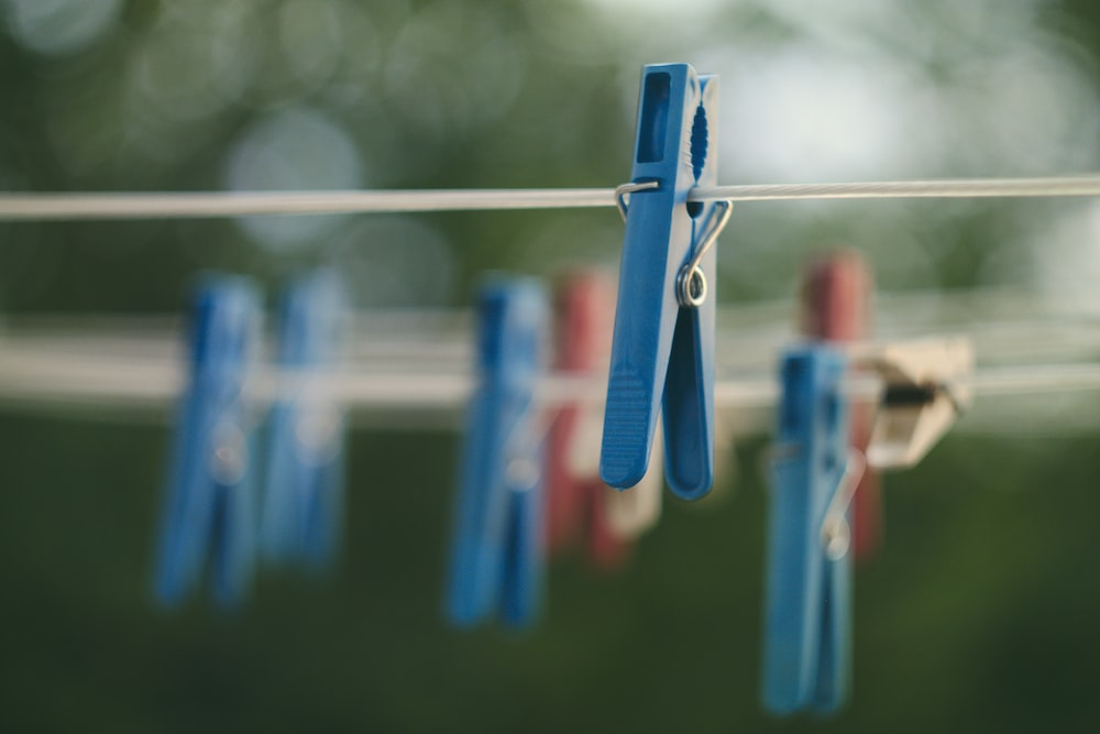 closeup photo of blue clothes peg