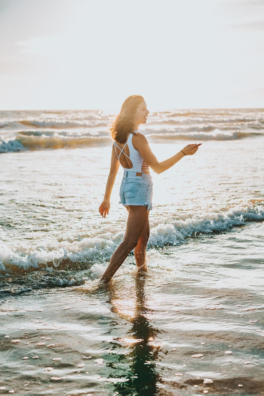 woman walking on seaside during daytime