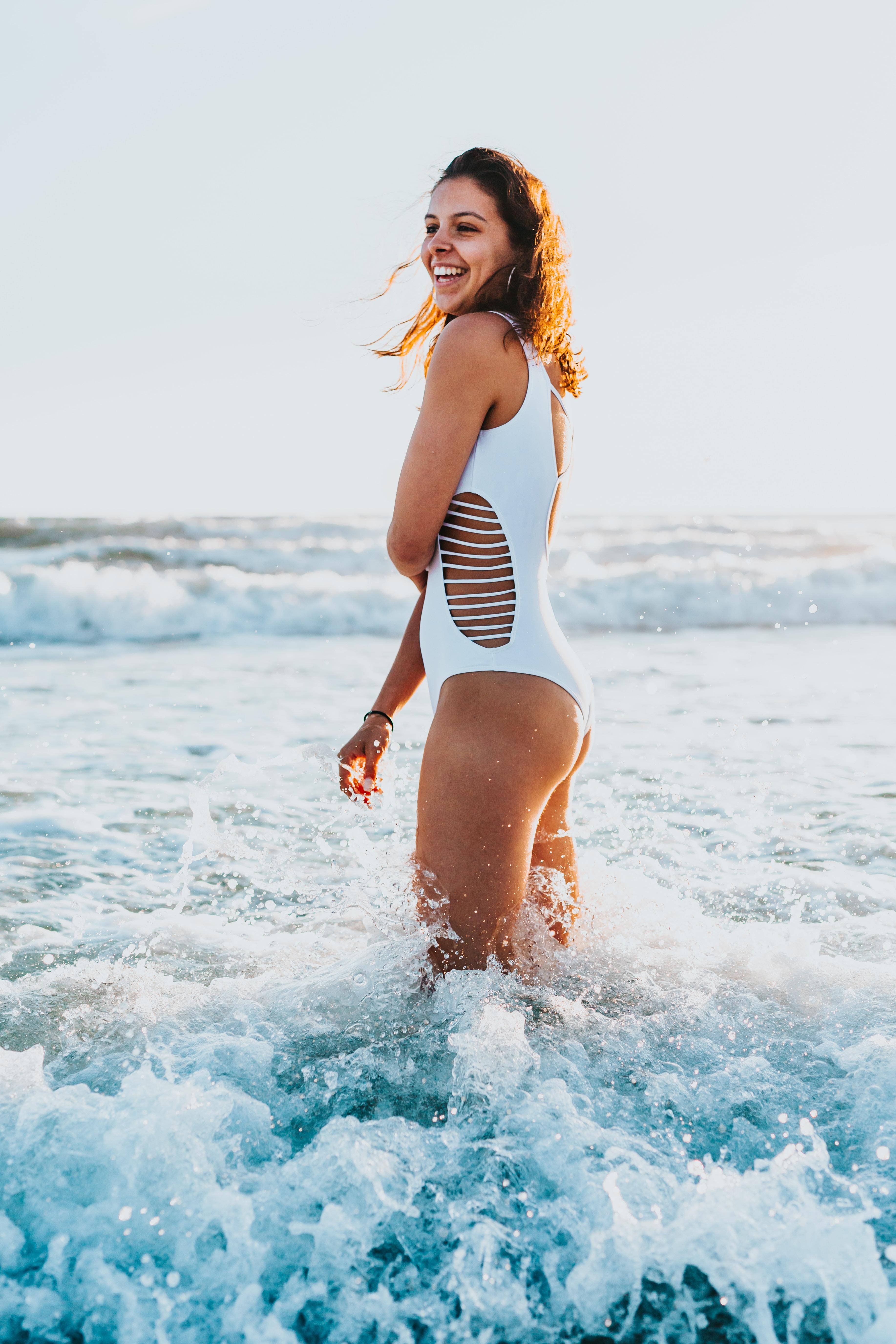 woman wearing monokini standing in the water