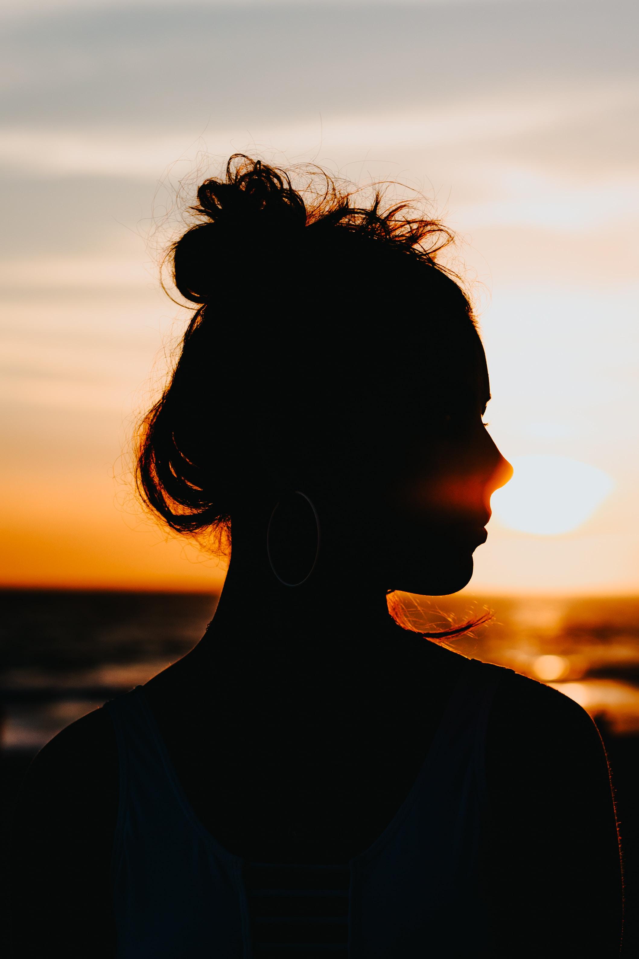 silhouette of woman looking sideways