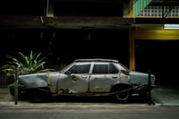 wrecked gray sedan